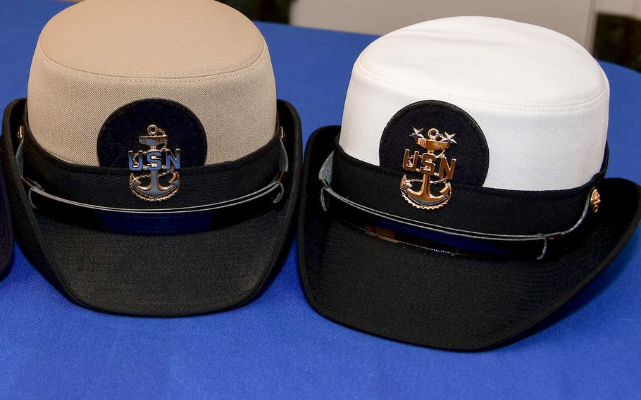 """Female combination, or """"bucket"""" covers, in white and khaki. The last day female officers and chief petty officers could wear the bucket was Oct. 31, 2018."""