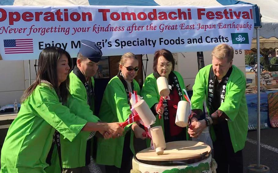 U.S. military and Miyagi prefecture officials crack open a barrel of sake to kick off the Operation Tomodachi Festival at Yokota Air Base, Japan, Saturday, Nov. 3, 2018.