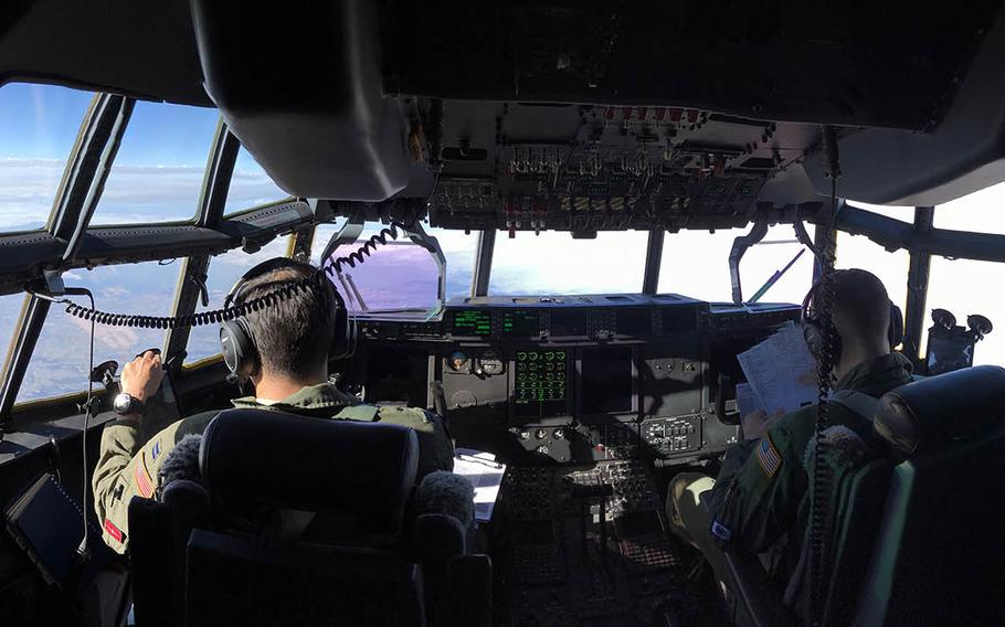 A C-130J Super Hercules assigned to the 374th Airlift Wing at Yokota Air Base, Japan, flies to Tsuiki Air Base in Fukuoka prefecture to collect 70 Japanese paratroopers for a Keen Sword training drill, Sunday, Nov. 4, 2018.