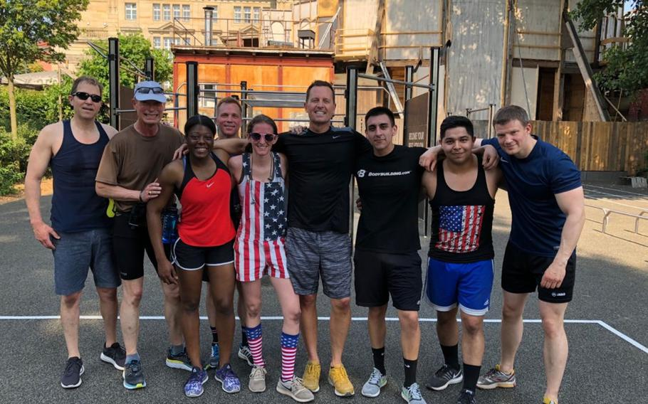 U.S. Ambassador to Germany Richard Grenell poses with embassy Marines during a Memorial Day fitness challenge in Berlin, May 28, 2018.