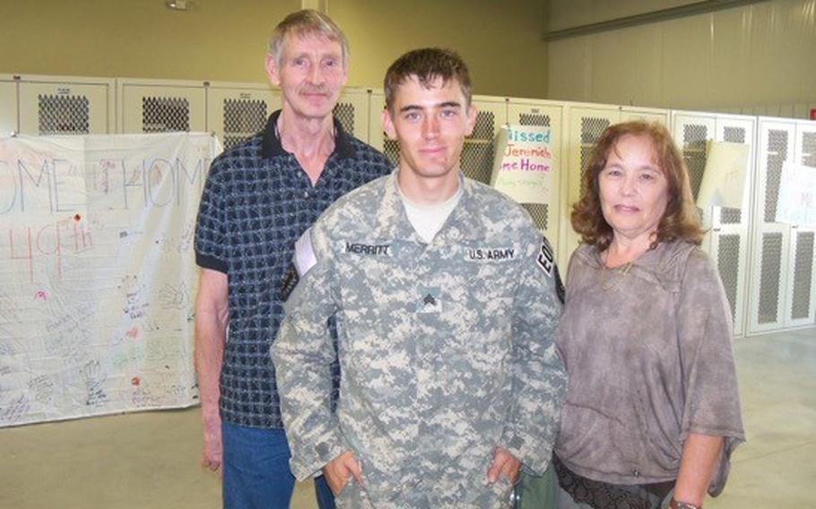 Steve and Carol Merritt stand with their son, Aaron after he returned from a deployment to Afghanistan. In 2014, Staff Sgt. Aaron Merritt died in a VA hospital. The VA settled a lawsuit in connection with his death for $2.5 million.