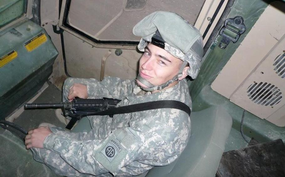 U.S. Army Staff Sgt. Aaron Merritt sits in a armored vehicle in Iraq. Merritt did one tour in Iraq, and two in Afghanistan. He later died in 2014 while being treated for colitis at a VA hospital. The VA recently agreed to a $2.5 million settlement with his parents in connection with his death.