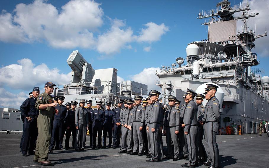 Midshipmen and cadets from South Korea's Army, Navy and Air Force academies visit the USS Wasp at Sasebo Naval Base, Japan, Tuesday, Nov. 6, 2018.