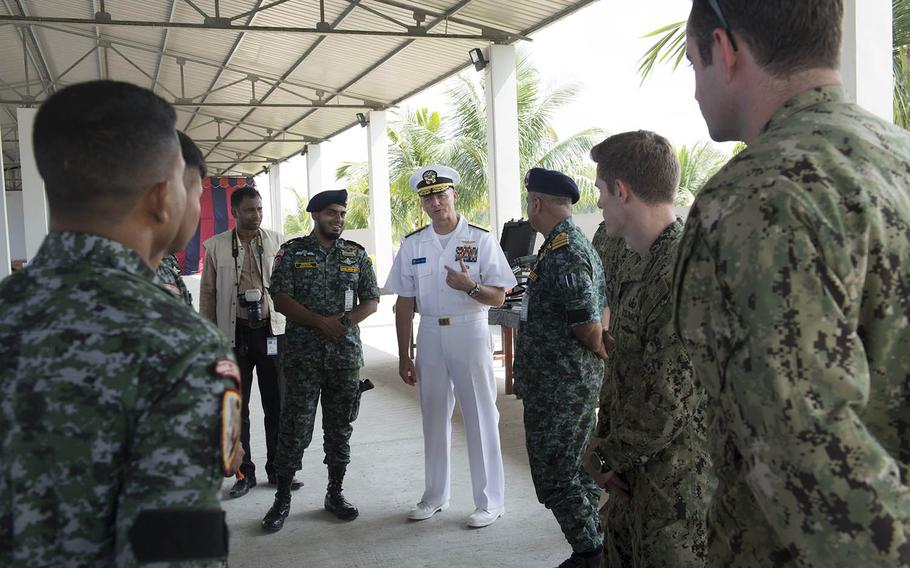 Rear Adm. Joey Tynch, Task Force 73 commander, speaks with explosive ordnance disposal technicians from the U.S. and Bangladesh navies during Cooperation Afloat Readiness and Training this week in Bangladesh.