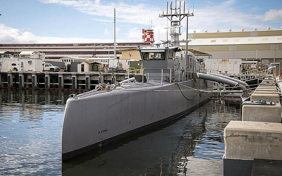 The Sea Hunter drone ship docked at Joint Base Pearl Harbor-Hickam, Hawaii, is the first in a new class of unmanned ships expected to one day complement the Navy's manned fleet.