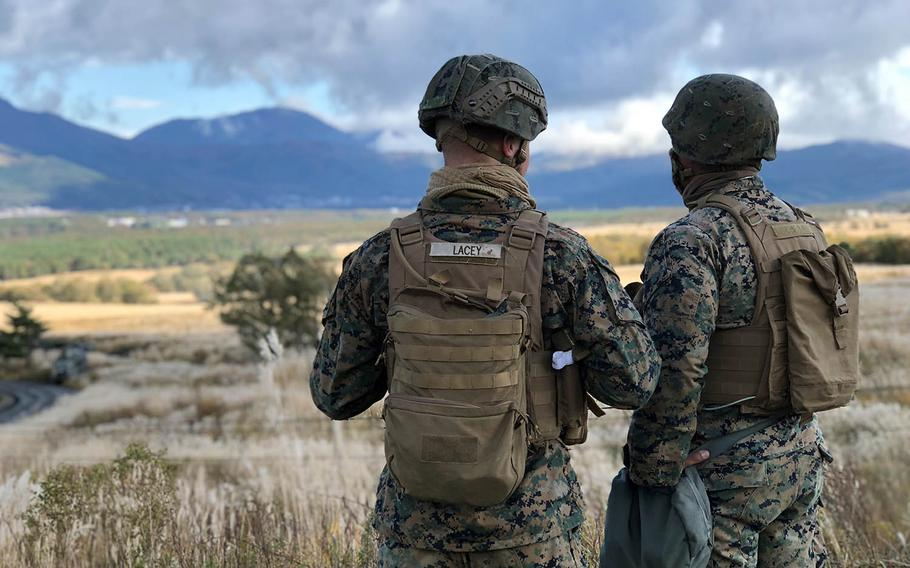 Okinawa-based Marines look over the North Fuji maneuver area at Camp Fuji, Japan, during a Artillery Relocation Training Program exercise, Sunday, Oct. 28, 2018.