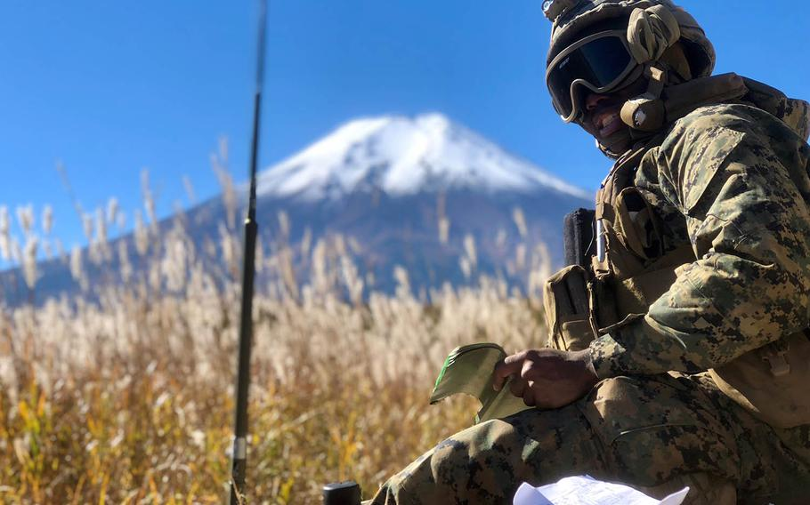 An Okinawa-based Marine takes part in an Artillery Relocation Training Program exercise late last month near Mount Fuji, Japan.
