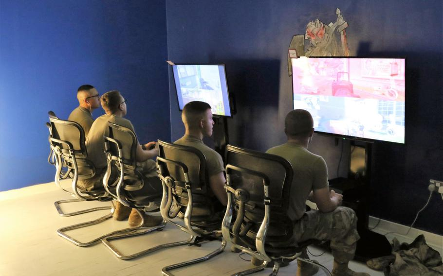 Servicemembers playing video games at the remodeled USO Camp Arifjan, Kuwait December 17, 2017.
