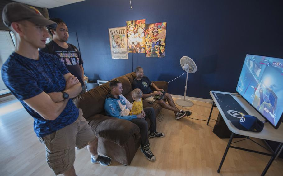 Spectators watch the 2018 Overwatch championship intramural finals in Colorado Springs, Colo., Sept. 7, 2018. The match ended with the 1st Space Operations Squadron triumphing over the 4th Space Operations Squadron with a score of 3-2.  William Tracy/U.S. Air Force