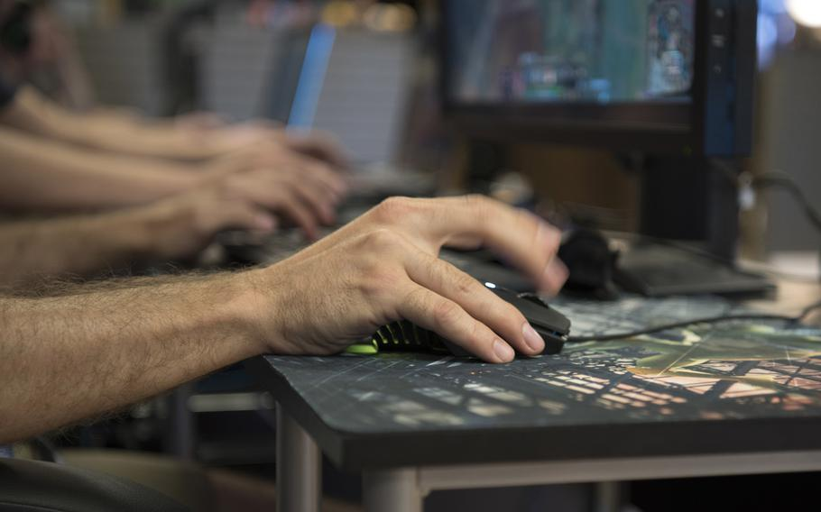 A competitor rapidly clicks his mouse during the 2018 Schriever Air Force Base, Colo., ?League of Legends? Championship Intramural Finals in Colorado Springs, Colo., June 6, 2018. The game requires constant input from the player in order to keep their character mobile and responsive.  William Tracy/U.S. Air Force