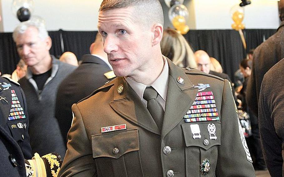 Sergeant Major of the Army Dan Dailey wears the then-proposed new service uniform at the Army-Navy football game in Philadelphia, Dec. 9, 2017.