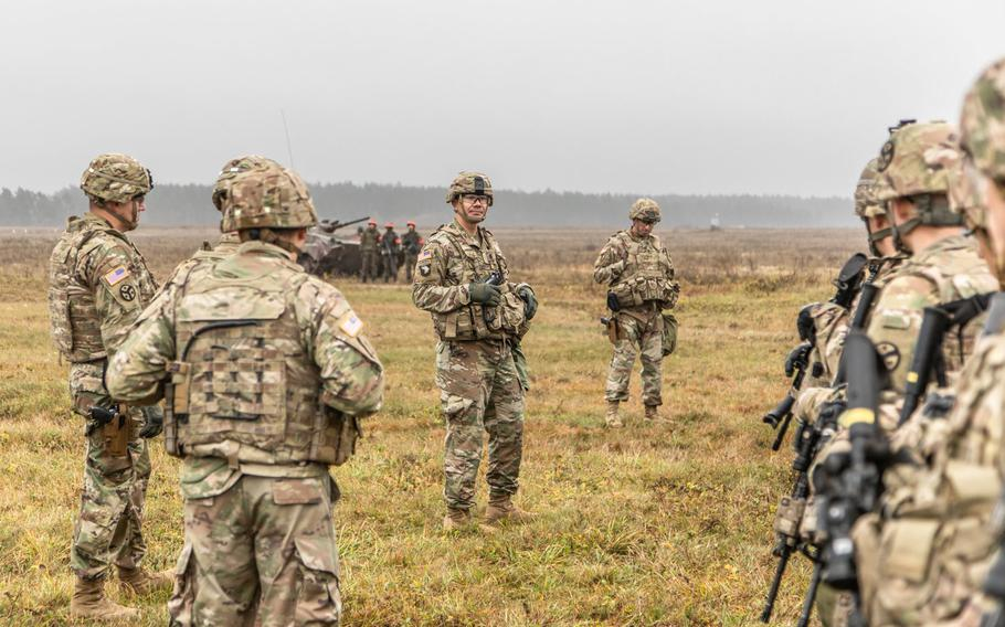 U.S. Army Lt. Col. Donny Hebel, Commander of Battle Group Poland, briefs his troops of following the opening ceremony of the NATO joint training exercise, Anakonda 18 at Bemowo Piskie Training Area, Poland, Nov. 7, 2018.