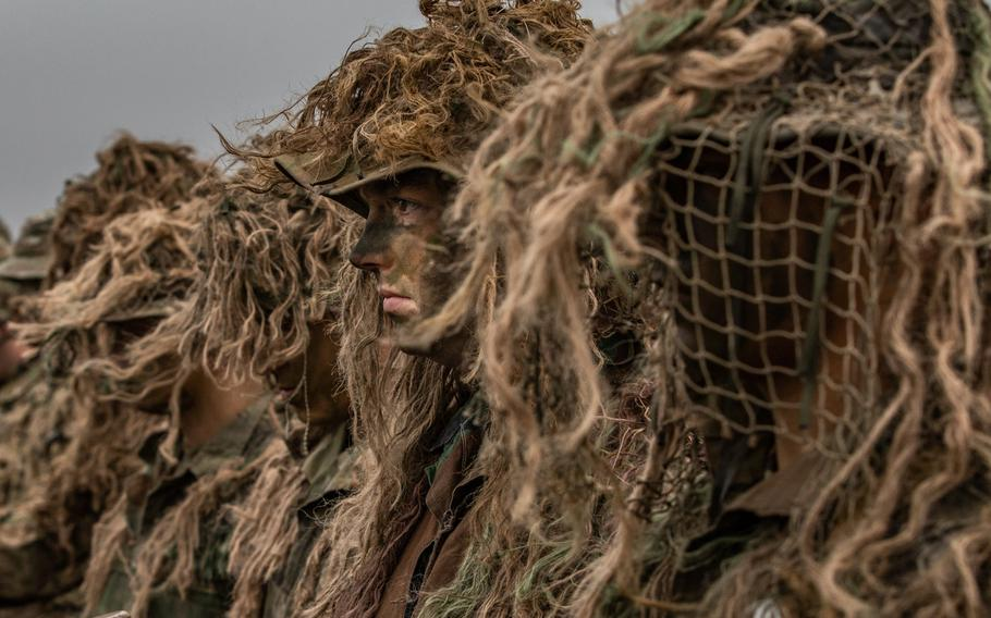 American snipers with Battle Group Poland stand at the position of attention during the opening ceremony of the NATO joint training exercise, Anakonda 18, at Bemowo Piskie Training Area, Poland, Nov. 7, 2018.