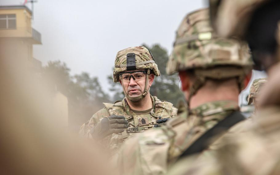U.S. Army Command Sgt. Maj. Charles Haynes, Battle Group Poland's senior enlisted leader, meets with his non-commissioned officers ahead of the opening ceremony of the NATO joint training exercise, Anakonda 18, at Bemowo Piskie Training Area, Poland, Nov. 7, 2018.