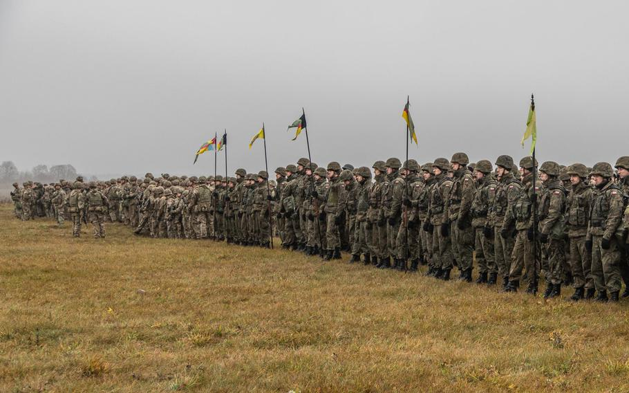 Soldiers of Battle Group Poland gather for the opening ceremony of the NATO joint training exercise, Anakonda 18 at Bemowo Piskie Training Area, Poland, Nov. 7, 2018.