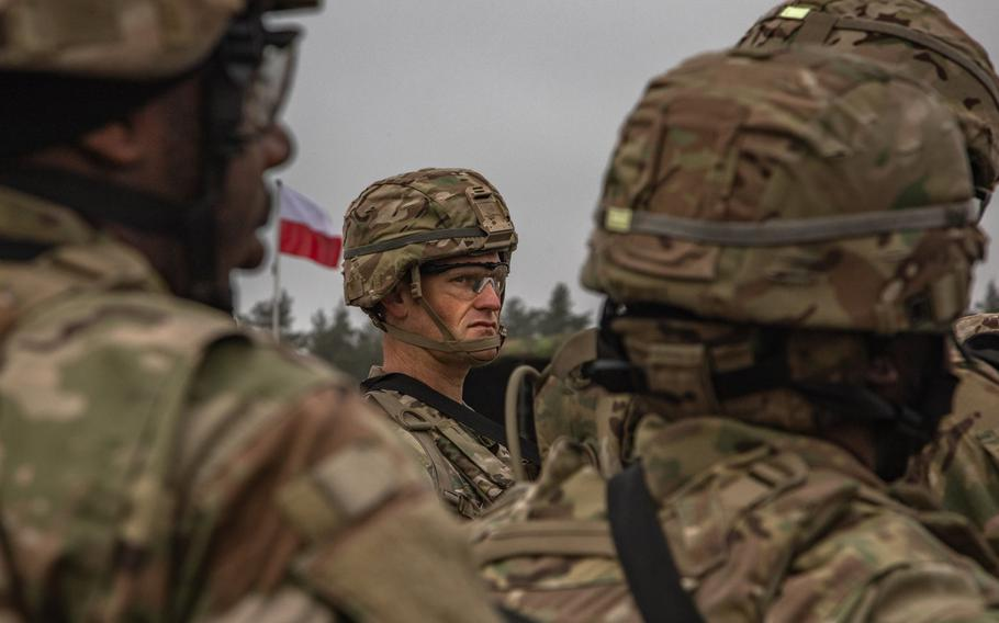 U.S. Army Staff Sgt. Joe Lewis, an infantryman assigned to Battle Group Poland, attends the opening ceremony of the NATO joint training exercise, Anakonda 18, at Bemowo Piskie Training Area, Poland, Nov. 7, 2018.