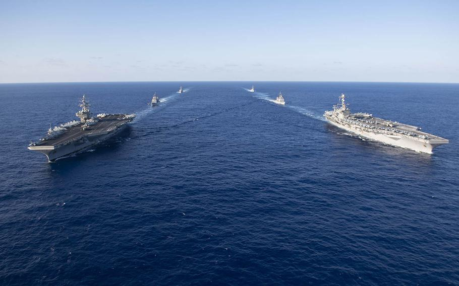 Ships with the USS Ronald Reagan and John C. Stennis carrier strike groups transit the Philippine Sea, Friday, Nov. 16, 2018.
