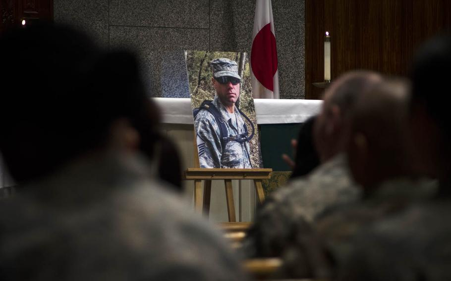 Airmen attend a memorial ceremony for Master Sgt. Nicholas Vollweiler at Yokota Air Base, Japan, Friday, Nov. 16, 2018. The 35-year-old was stabbed to death at his home a week earlier.