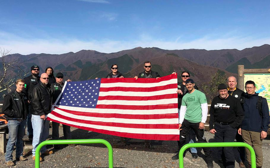 Motorcyclists from the U.S. military riding community carried a flag through the mountains west of Tokyo on Saturday, Nov. 17, 2018, in memory of Master Sgt. Nicholas Vollweiler, 35, who was recently stabbed to death near Yokota Air Base, Japan.