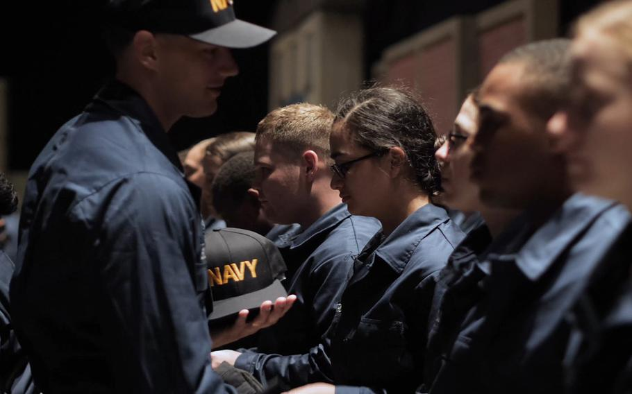 Sailors receive Navy ball caps during a recent boot camp at Recruit Training Command in Great Lakes, Ill.
