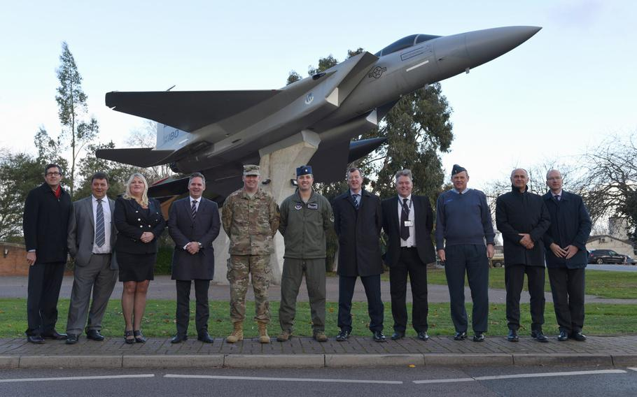 Leaders from RAF Lakenheath, the Defense Infrastructure Organisation, Air Force Civil Engineer Center, West Suffolk and Kier VolkerFitzpatrick pose for a photo at RAF Lakenheath, England, Monday, Nov. 19, 2018. The Defence Infrastructure Organisation awarded a contract worth 160 million pounds to ready RAF Lakenheath for two squadrons of F-35 Lightnings.