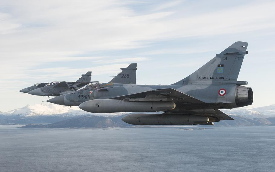 Three French Mirage 2000Cs fly in Norwegian airspace during the exercise Trident Juncture 2018 on Oct 28. German and French leaders have raised the possibility of setting up a European army.