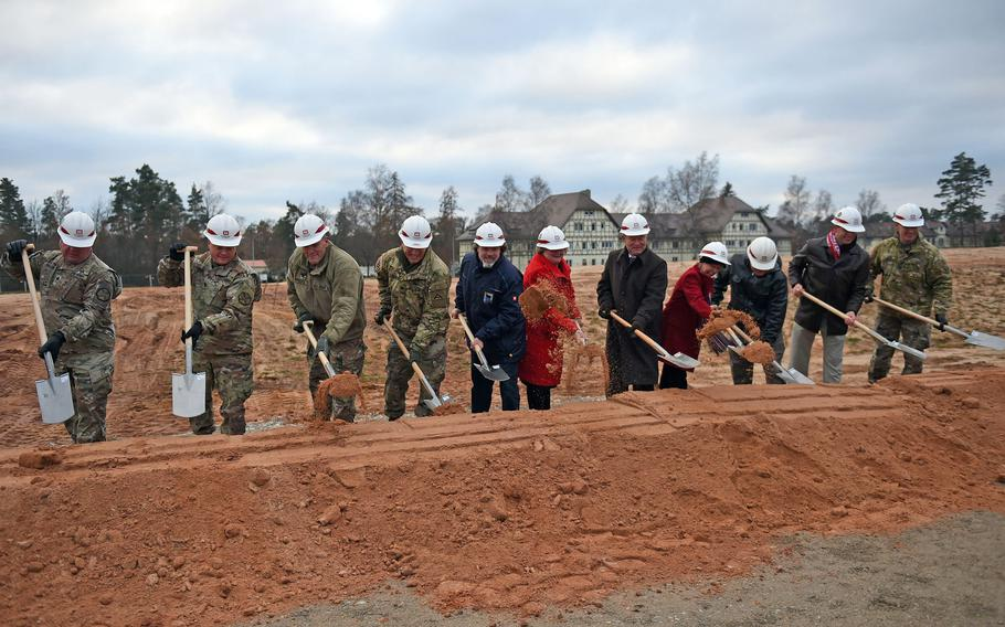 Army and community leaders shovel dirt at the groundbreaking for the new elementary school at Grafenwoehr, Germany, Tuesday, Nov. 20, 2018.