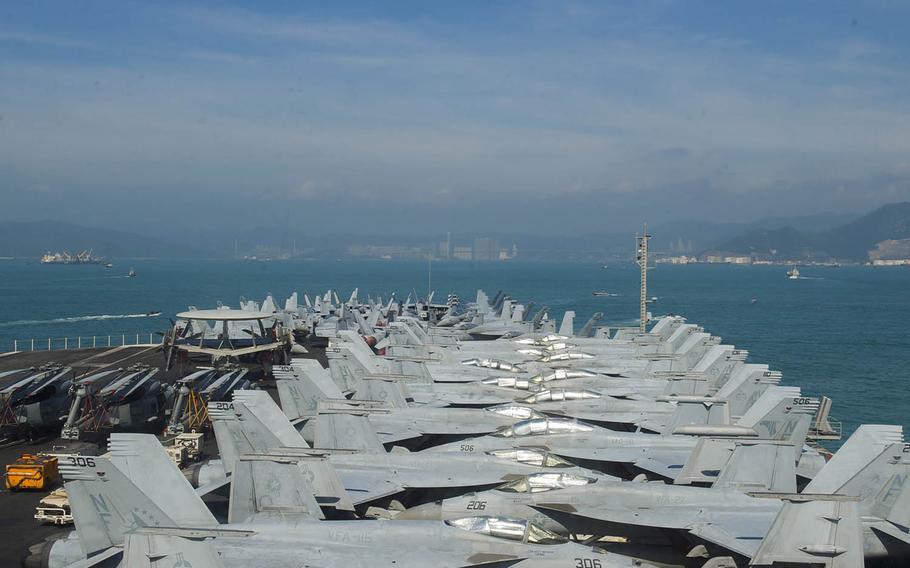 The aircraft carrier USS Ronald Reagan approaches Hong Kong, Wednesday, Nov. 21, 2018.