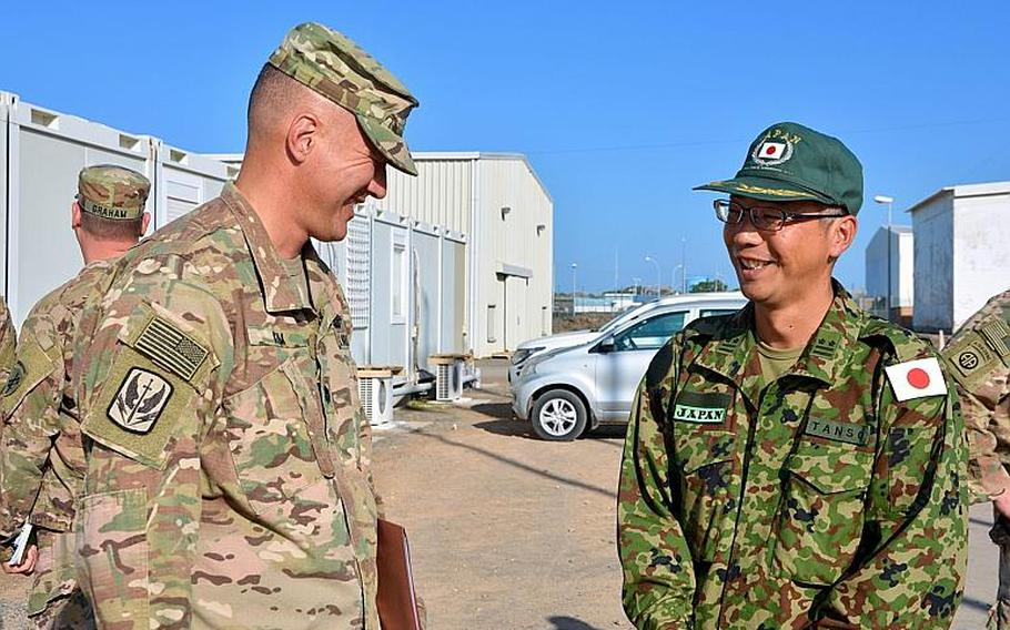 U.S. Army Lt. Col. Kenneth Kim, commander of the 403rd Civil Affairs Battalion, Mattydale, N.Y., meets with Lt. Col. Masatoshi Tanso at Japan Self-Defense Force Base, Djibouti, Nov. 21, 2018. Japanese and U.S. leadership met to discuss ways to build relationships in the area.