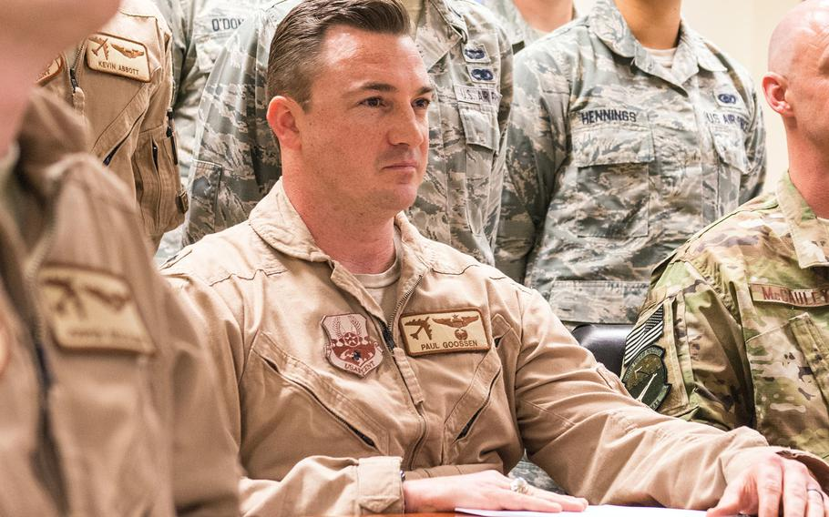 Lt. Col Paul Goossen and other servicemembers take part in a holiday conference call with President Donald Trump at Al Udeid Air Base, Qatar, Dec. 24, 2017. Goossen was removed from command of the 69th Bomb Squadron due to a loss of trust and confidence from his failure to maintain a professional workplace environment.