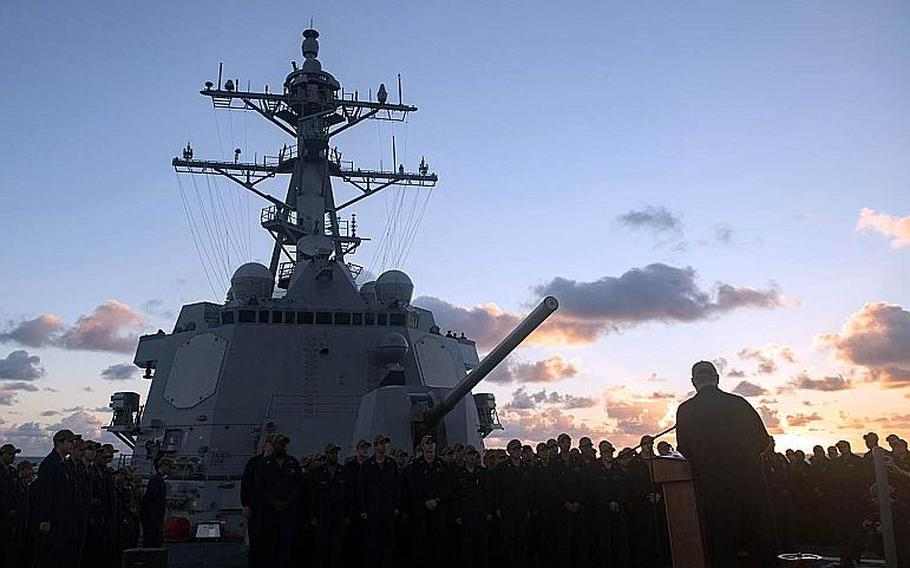 Cmdr. Leonard Leos addresses the crew of USS Stockdale after assuming command of the Arleigh Burke-class guided-missile destroyer Nov. 1, 2018, in a change of command ceremony held during routine operations in the Pacific Ocean.