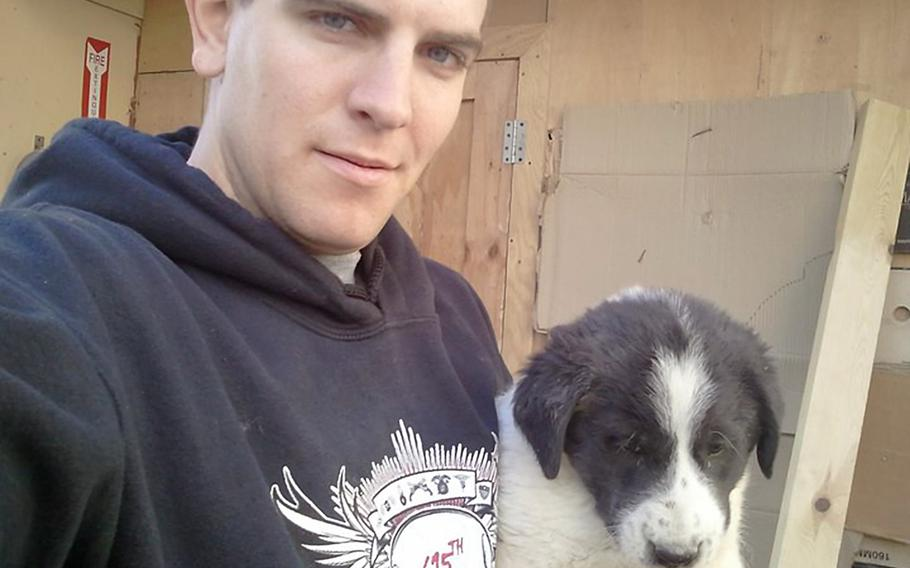 Spc. Kevin Shumaker holds a puppy on Combat Outpost Base Chamkani, Afghanistan. Shumaker, 24, died of rabies in August 2011, seven months after being bitten by a dog while breaking up a dog fight on the base. His death was the first confirmed military rabies death in 40 years, and an investigation revealed a series of mistakes and omissions in treating him.