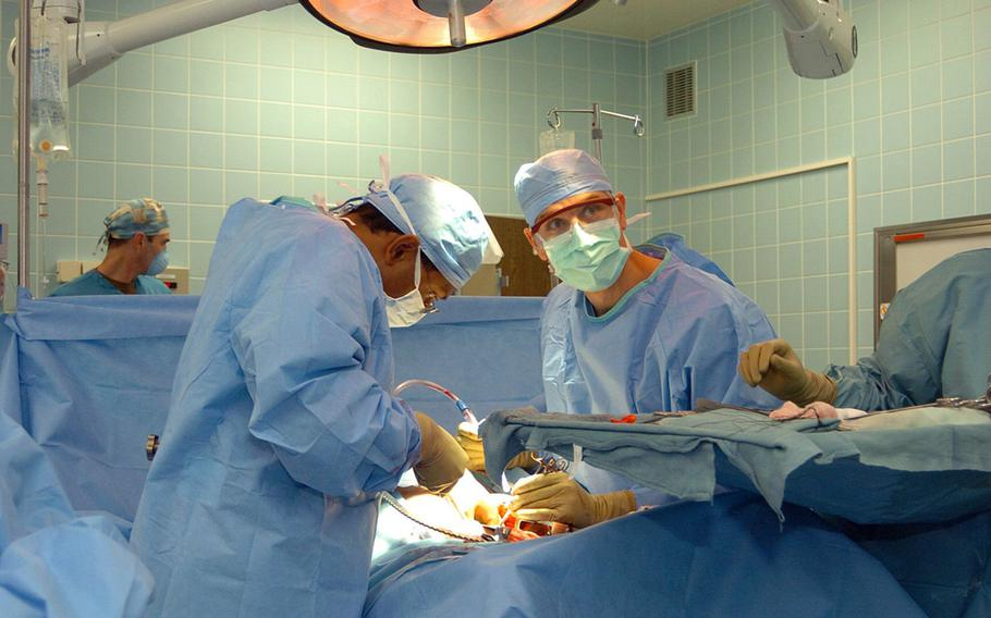 Doctors perform a surgery at Landstuhl Regional Medical Center. A shortage of civilian doctors in military hospitals is causing treatment problems, according to a Government Accountability Office report.