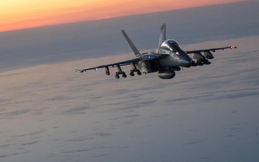 A U.S. Navy F/A-18E/F Super Hornet flies over Afghanistan in December 2017. The U.S. dropped more bombs and other munitions in Afghanistan during the first ten months 2018 than in any other full year since at least 2006, when documentation began.