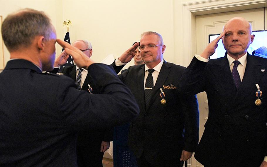 U.S. Air Force Maj. Gen. John Williams, Mobilization Assistant to the commander, U.S. Air Forces in Europe- Air Forces Africa, salutes the Swedish pilots who were awarded the U.S. Air Medal in Stockholm, Sweden, on Nov. 28, 2018. Gen. Williams thanked the four pilots who risked their lives to save an SR-71 and the two Americans on board  in 1987.