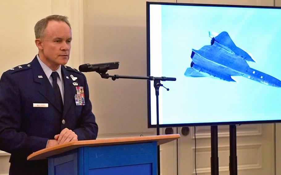U.S. Air Force Maj. Gen. John Williams, Mobilization Assistant to the commander, U.S. Air Forces in Europe-Air Forces Africa, talks about the Swedish pilots who were awarded the U.S. Air Medal in Stockholm, Sweden, Nov. 28, 2018. Pictured next to Williams is an SR-71, the same type of plane that the Swedish pilots helped escort to safety after it had an inflight emergency on June 29, 1987.