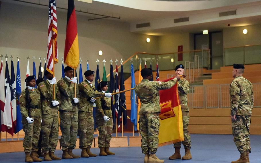 Sgt. Maj. Samuel Zoker, left, and Col. Seth Knazovich, the sergeant major and commander of the 41st Field Artillery Brigade, respectively, uncase the unit's colors at the activation ceremony, at Grafenwoehr, Germany, Friday, Nov. 30, 2018.