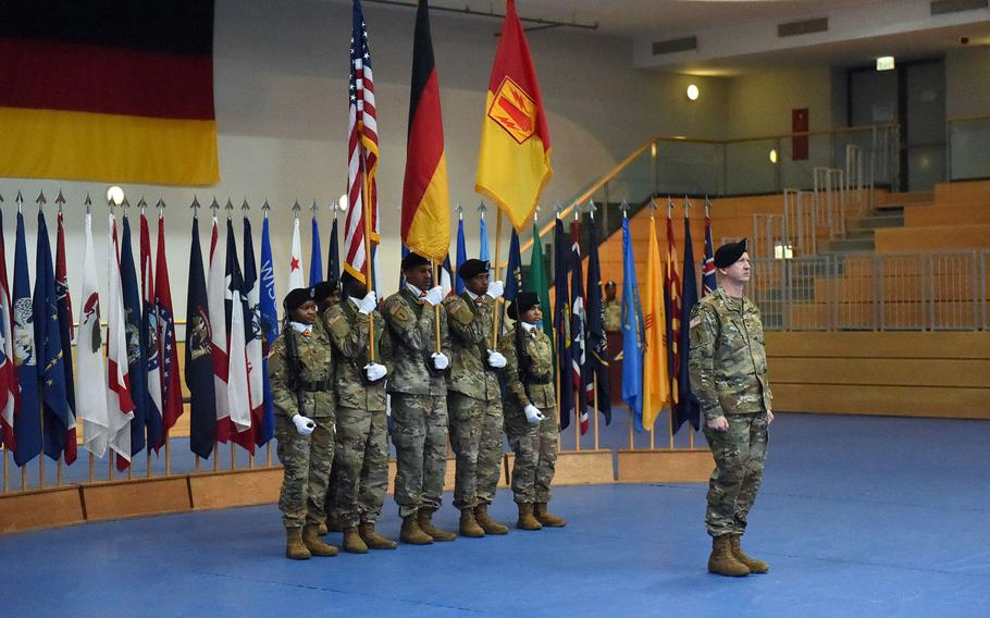 Col. Seth Knazovich, the  commander of the 41st Field Artillery Brigade, stands in front of a crowd at the activation ceremony, at Grafenwoehr, Germany, Friday, Nov. 30, 2018.