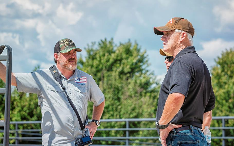 John Parker, development director, photographer and Navy veteran, talks with a couple of combat veterans during a War Horses for Veterans summer group.