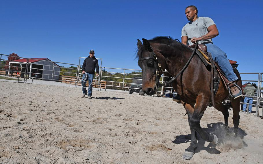War Horses for Veterans co-founder and director Patrick Benson teaches some basic riding skills to a combat veteran during one of a weekend retreat at the nonprofit's ranch in Stillwell, Kansas.