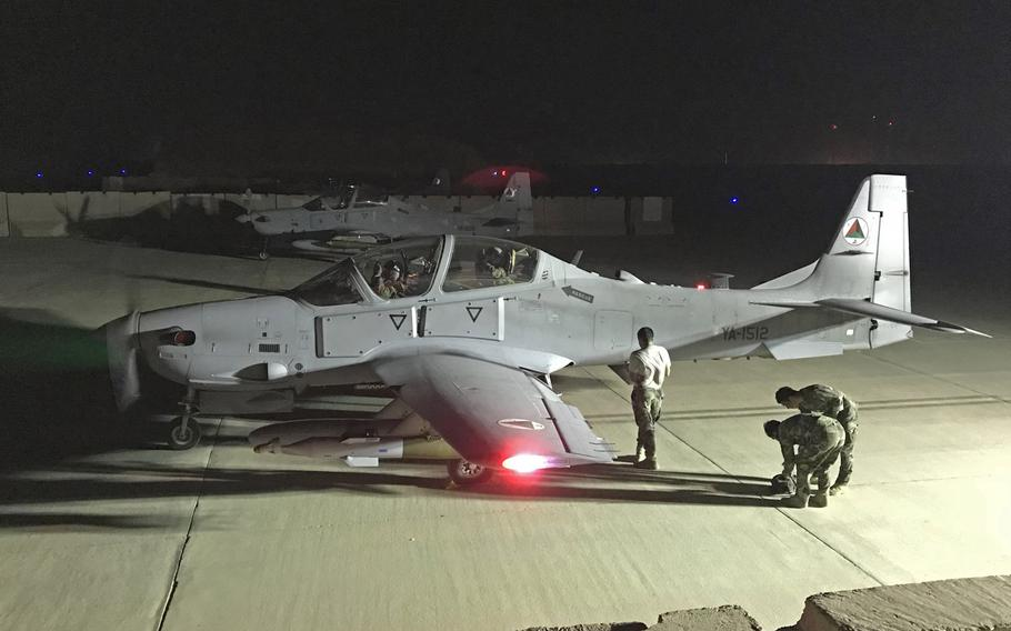 An Afghan air force A-29 is inspected after a night combat mission May 17, 2018, in Kabul, Afghanistan. The Afghan air force has conducted its first ever nighttime airstrikes after months of training by U.S. and international forces.