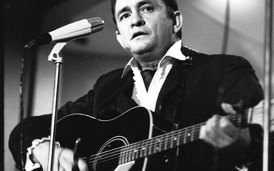 Johnny Cash performs for servicemembers at Rhein-Main Air Base, West Germany, in 1958. It was one of two shows he played at NCO clubs on the base that night. Cash served in the U.S. Air Force and was stationed at Landsberg Air Force Base from 1951 to 1954.