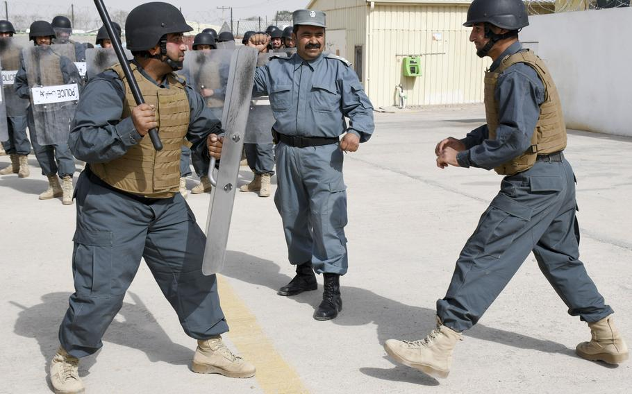 Afghan police in training conduct a crowd-control drill with a baton at the Regional Police Training Center in Herat, Oct. 28, 2018. Responsibility for training police primarily belongs to Afghan mentors, with allied troops now focusing on advising at higher echelons and with Afghan special operations.