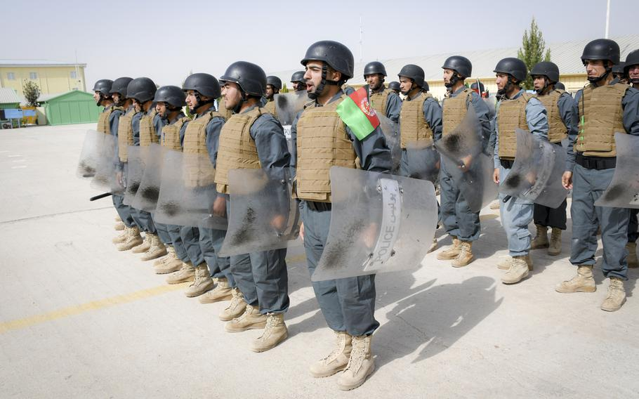 Afghan police in training bellow a warning before banging their batons on their riot shields during a crowd-control drill at the Regional Police Training Center in Herat, Oct. 28, 2018. Responsibility for training police primarily belongs to Afghan mentors, with allied troops now focusing on advising at higher echelons and with Afghan special operations.