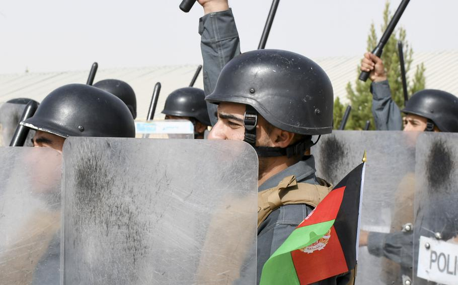 Afghan police in training raise their batons in the air before banging them on their riot shields during a crowd-control drill at the Regional Police Training Center in Herat, Oct. 28, 2018. Responsibility for training police primarily belongs to Afghan mentors, with allied troops now focusing on advising at higher echelons and with Afghan special operations.