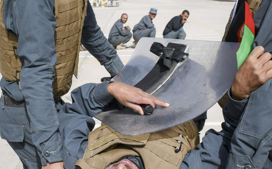 Afghan police in training carry a simulated injured officer away during a crowd-control drill at the Regional Police Training Center in Herat, Oct. 28, 2018. Responsibility for training police primarily belongs to Afghan mentors, with allied troops now focusing on advising at higher echelons and with Afghan special operations.    J.P. Lawrence/Stars and Stripes