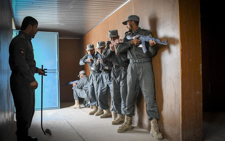 Afghan police in training prepare to clear a building at the Regional Police Training Center in Herat, Oct. 28, 2018. Responsibility for training police primarily belongs to Afghan mentors, with allied troops now focusing on advising at higher echelons and with Afghan special operations.