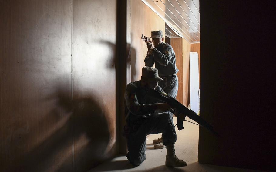Afghan police in training clear a building at the Regional Police Training Center in Herat, Oct. 28, 2018. Responsibility for training police primarily belongs to Afghan mentors, with allied troops now focusing on advising at higher echelons and with Afghan special operations.