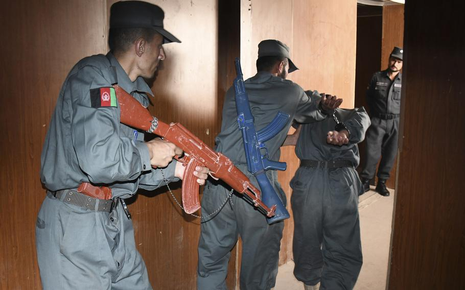 Afghan police in training practice detaining and arresting each other as an instructor looks on at the Regional Police Training Center in Herat, Oct. 28, 2018. Responsibility for training police primarily belongs to Afghan mentors, with allied troops now focusing on advising at higher echelons and with Afghan special operations.