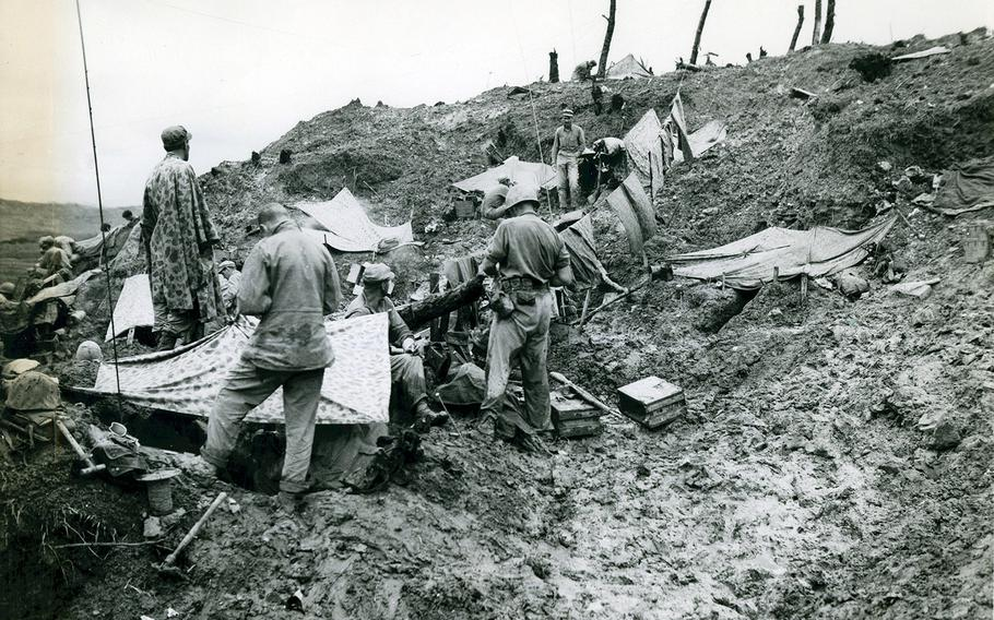 Marines camp on Sugar Loaf Hill during the Battle of Okinawa, May 26, 1945.
